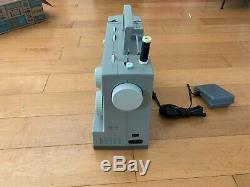 Singer 4452 Heavy Duty Sewing Machine + Accessories